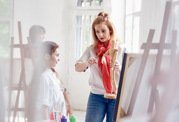 Art Lesson. little girl and woman education