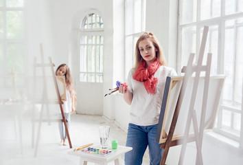 happy satisfied woman painter