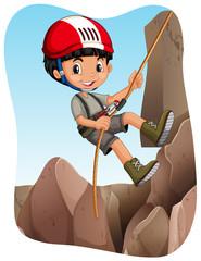 Boy climbing up the mountain