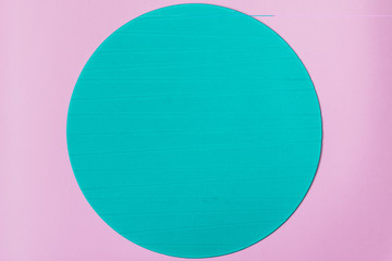 Blue round stand on pink background. Minimal concept. Flat lay, top view.