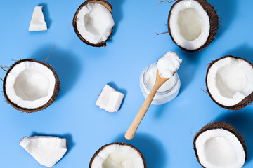 coconuts with coconut oil  on blue table