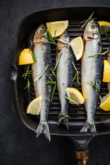 frying fish with lemon and herbs