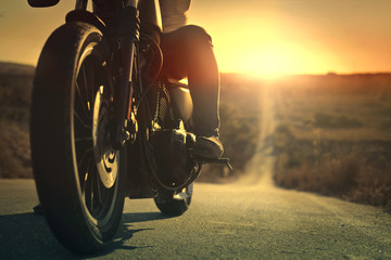 On a roaring motorcycle at sunset Wall mural