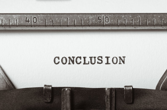 word conclusion typed on typewriter