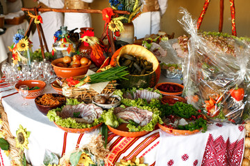 Pickled vegetables and cut meat lie on the table decorated in et