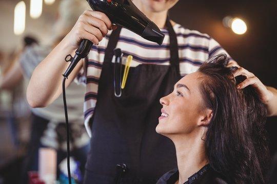 Pretty woman getting her hair dried
