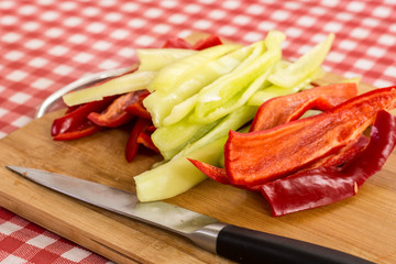 Sliced red and green paprika on the cutting board