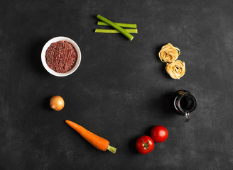 Ingredients of pasta bolognese with meat and vegetables