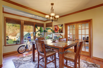 Dining area with hardwood floor. Wooden table set