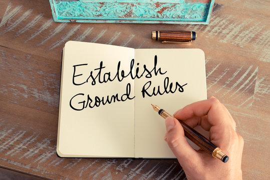 Handwritten text Establish Ground Rules on notebook