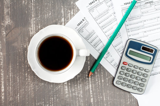 Coffee cup and tax forms