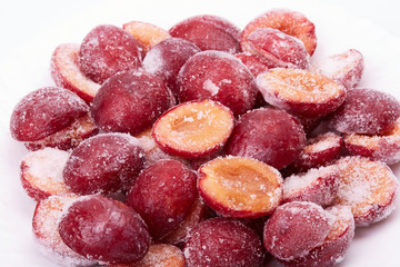 Frozen red plums