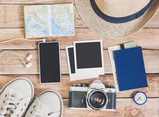 Accessories for travel. Passport, photo camera, credit card, smart phone and travel map. Top view. Holidays and tourism concept