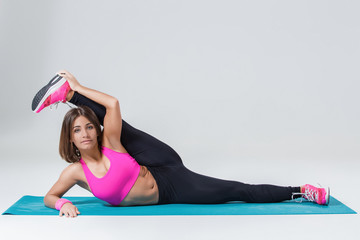 Sporty flexible girl doing stretching exercise