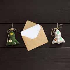 New Year card/ Two festive Christmas tree and an open letter to the place for congratulations on a wooden background