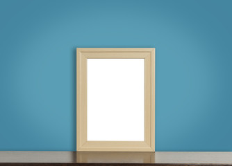 Blank wooden photo frame on rustic navy background.