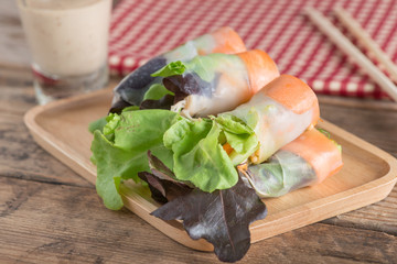 Salad roll vegetables with salad dressing.