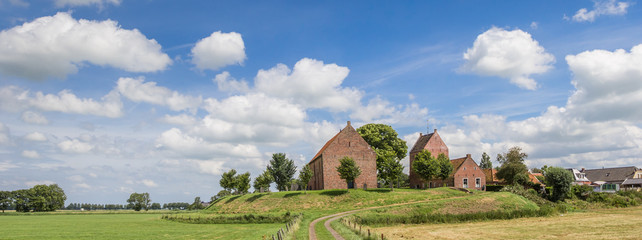 Fototapete - Panorama of medieval church of the Groningen village Ezinge