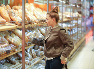 Woman choosing food from a supermarket