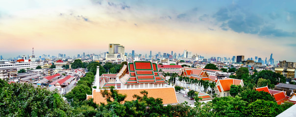 Panorama view of Wat Saket and Bangkok from Golden Mountain on sunset cloudy sky, Thailand