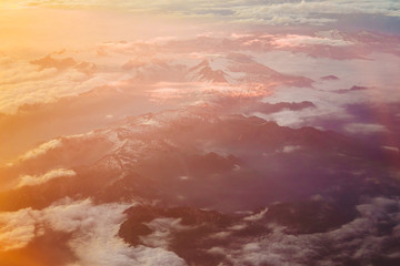 Sunset Over Mountains From Height Of Airplane. Bright Orange,