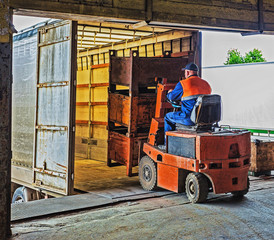 forklift operator at work in warehouse