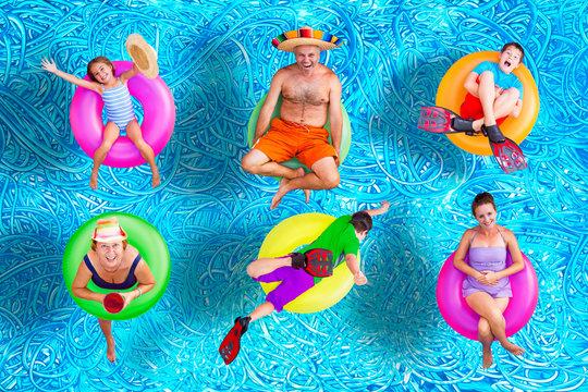 Family fun in the swimming pool in summer