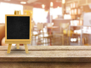 wooden table with blurred bokeh restaurant background with black