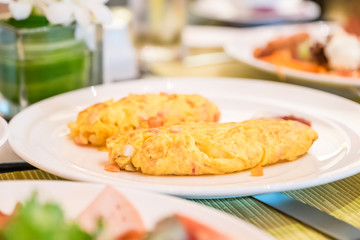 omelet on white plate on table