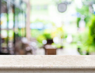 Empty luxury white marble table top with blurred cafe bokeh ligh