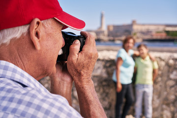 Grandparents With Boy Family Holidays Grandpa Taking Photo