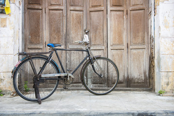 Old bicycle in front of an ancient house