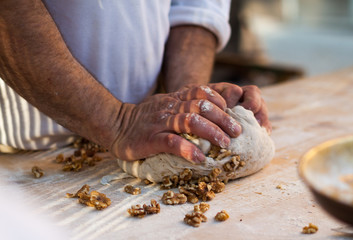 Man knead the dough
