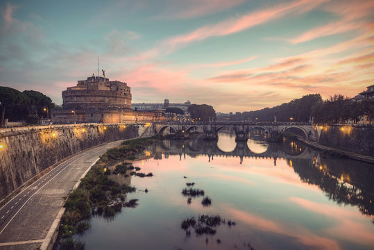 The fortress of Sant'Angelo (Castel Sant'Angelo) and bridge over river Tiber (Fiume Tevere) at a spectacular sunrise, Rome, Italy, Europe, vintage filtered style
