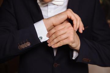Businessman hands with cufflinks. Elegant gentleman clother