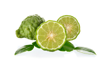 whole and half cut Bergamot with lime leaf on the white backgrou