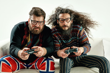 Funny portrait of two best friends playing games