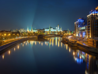 Moscow Kremlin at night, view from bridge across the river. Peaceful night scene: clear sky and city lights reflected in calm water. High dynamic range photo, combined from 6 different exposures.