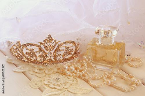 """White pearls necklace, diamond tiara and perfume bottle ..."