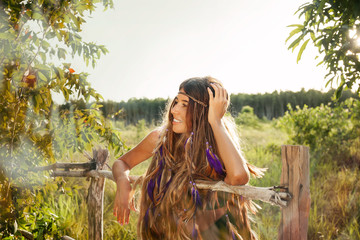 Fashion portrait of beautiful hippie young woman outdoors. bohemian style