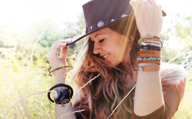 Fashion smiling woman portrait with hat on a head