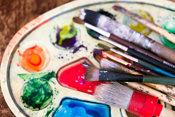 the palette with colored paints