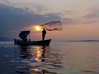 Fisherman and ships on the Golyazi lake at Bursa city, Turkey
