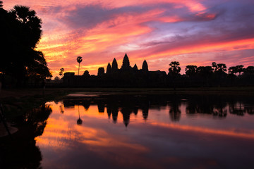 Angkor Wat temple at dramatic sky twilight sunrise