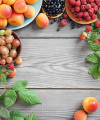 Ceramic plates with different fruit and berries  on old wooden table. Top view, high resolution product.