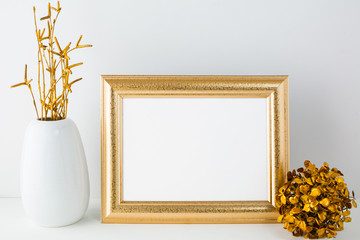 Landscape gold frame mockup with golden decor