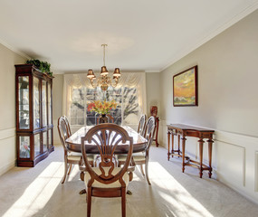 Dining area with antique furniture and carpet floor