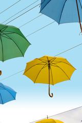 Multicolor umbrellas in blue sky
