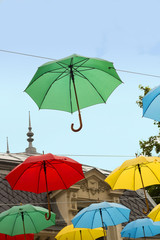 Multi colored umbrellas in blue sky