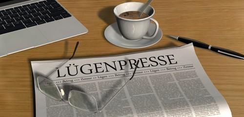 Zeitung auf Schreibtisch - Lügenpresse